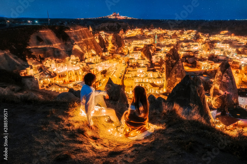 Fotografie, Tablou Asian Couple in love and looking night view of Uchisar Goreme sunset view point ,Cappadocia