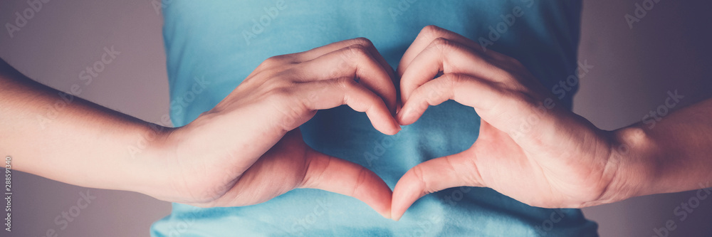 Fototapety, obrazy: Woman hands making a heart shape on her stomach, healthy bowel degestion, probiotics  for gut health, International Day of Sign Languages