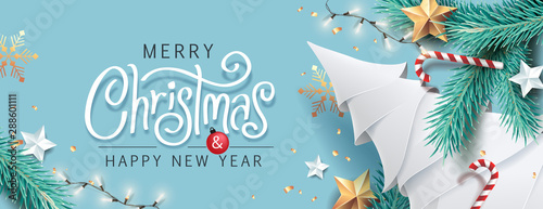 Merry Christmas and Happy New Year background for Greeting cards with tree Branches christmas tree gold paper and gold stars.Merry Christmas vector text Calligraphic Lettering Vector illustration. - 288601111