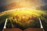 open fairytale  magic book. beautiful mountain view. natural summer (spring) background. amazing landscape