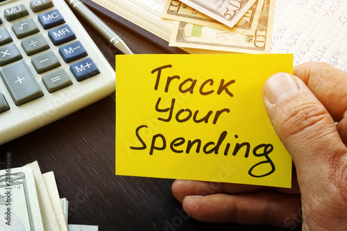 Fotomural Track your spending sign and book with home budget.