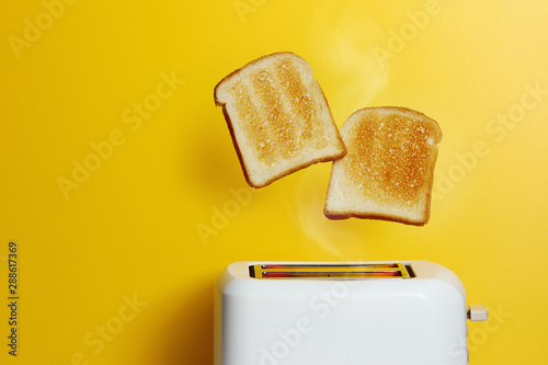 Fényképezés Slices of toast jumping out of the toaster