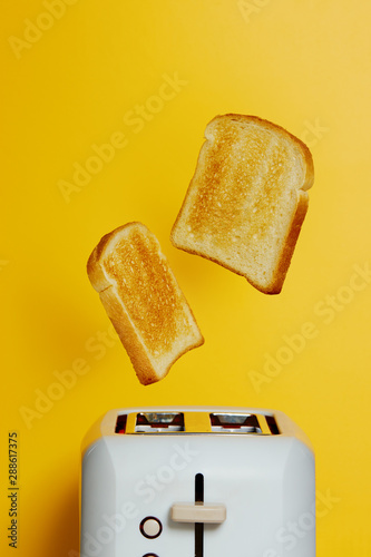 Obraz na plátně  Slices of toast jumping out of the toaster