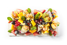 Exotic Fruit Plate Or Vegan Platter With Sliced Fruits And Berries