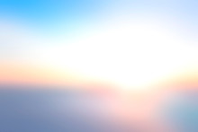 Hope Concept: Bokeh Light And Abstract Blurry Blue Sky And Clouds Mountain Sunrise Background
