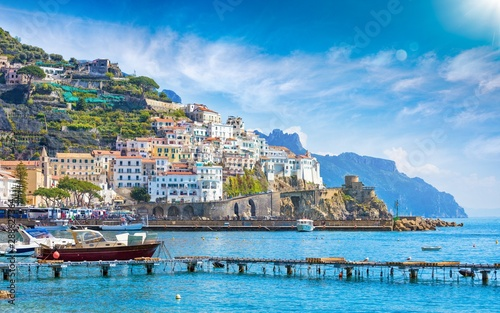 View for sea to beautiful Amalfi on hills leading down to coast, Campania, Italy