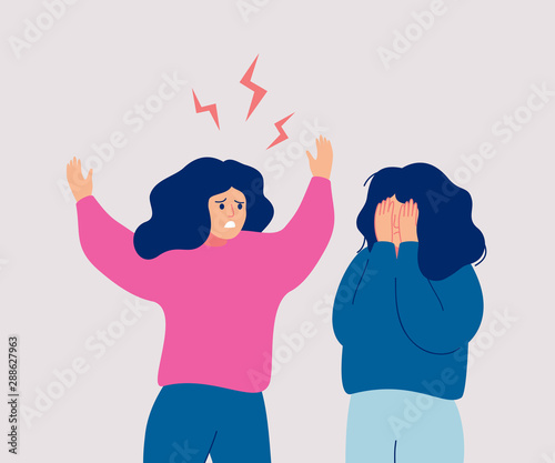 An angry woman screams at a crying woman who covers her face with her hands Wallpaper Mural