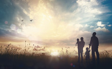 Family Worship God Concept: Silhouette People Looking For The Cross On Autumn Sunrise Background