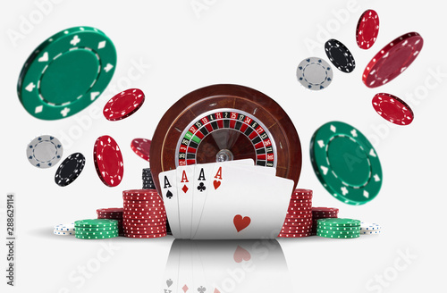 Photo Four aces standing ahead of a brown roulette and chips in piles which flying apart, isolated on white background