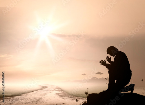Fototapety, obrazy: Pray concept: Humble man kneeling to praise and worship God on mountain sunset background