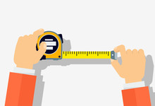 Measuring Tape In The Hands Of...
