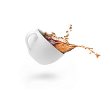 Coffee Splash In White Cup Isolated