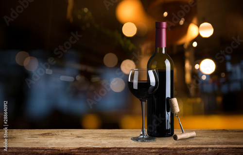 Autocollant pour porte Vin Expensive wine bottles collection and wooden barrel in the cellar, wine tasting and production concept