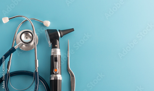 Otoscope with stethoscope on blue background. Canvas Print
