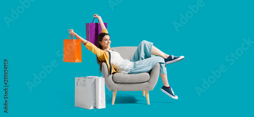 Fototapeta Cheerful shopaholic woman with shopping bags obraz
