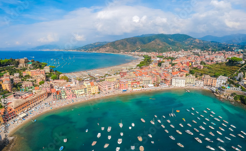 Poster de jardin Europe Méditérranéenne Sea aerial landscape in Sestri Levante, Liguria, Italy. Scenic fishing village with traditional houses and clear blue water. Summer vacation rich resort with picturesque harbour and nice sand beach