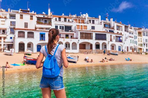 Tourist woman in Calella de Palafrugell, Catalonia, Spain near of Barcelona Fotobehang