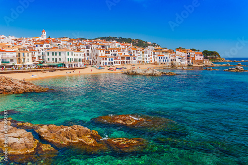 Foto auf Leinwand Blau türkis Sea landscape with Calella de Palafrugell, Catalonia, Spain near of Barcelona. Scenic fisherman village with nice sand beach and clear blue water in nice bay. Famous tourist destination in Costa Brava
