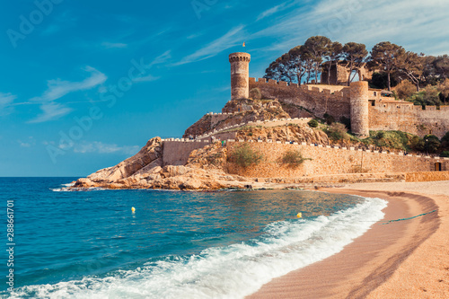 Foto auf Gartenposter Barcelona Sea landscape Badia bay in Tossa de Mar in Girona, Catalonia, Spain near of Barcelona. Ancient medieval castle with nice sand beach and clear blue water. Famous tourist destination in Costa Brava