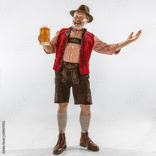 Fotografering Portrait of Oktoberfest senior man in hat, wearing the traditional Bavarian clothes
