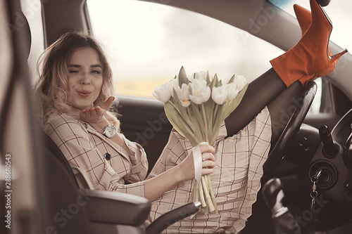 Obraz girl spring auto / happy girl in the car, travel spring mood happiness - fototapety do salonu