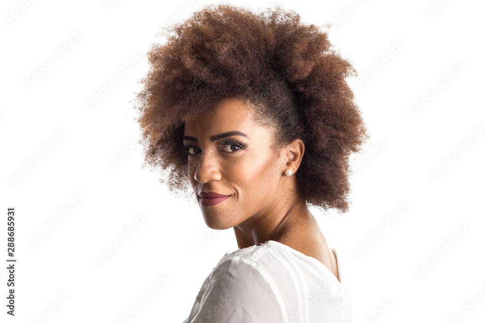 Fototapeta afro hair black brazilian girl sideways feeling happy and carefree. Standing against white background. Isolated on white background.