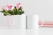 Two Mugs Mockup With Books And Pink Roses In A Pot On A White Table.