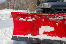 Red Snowplow Covered With Snow