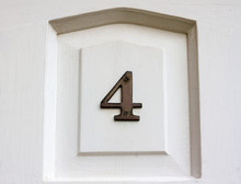 House Number 4 On A White Front Door