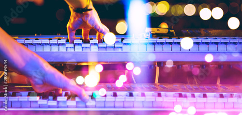 Live music and music festival background.Instrument on stage and band.Stage lights.Abstract musical background.Playing piano and concert concept. - 288693544