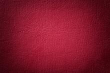 Dark Red Leather Texture Background. Closeup Photo.