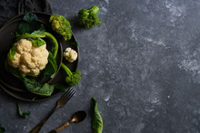 Organic Cauliflower And Broccoli On A Plate On A Dark