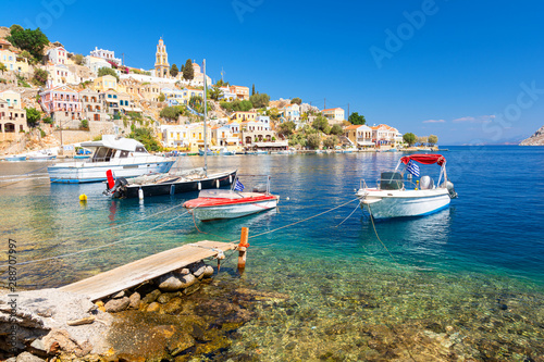 Boats and colorful houses in bay of Symi, symi island, Greece Canvas Print