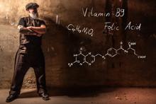 Bearded Old Man Presenting Handdrawn Chemical Formula Of Vitamin B9