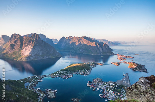 Foto op Canvas Nachtblauw Beautiful scenery of Reine on top of Reinebringen during sunset time on a clear summer day, Lofoten Islands, North Norway