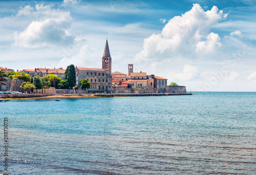 Poster de jardin Europe Méditérranéenne Amazing spring view of old Assumption of Mary church. Sunny morning cityscape in Porec, Croatia, Europe. Traveling concept background.