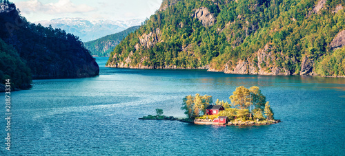 Obraz Picturesque summer panorama with small island with typical Norwegian building on Lovrafjorden flord, North sea. Colorful morning view in Norway. Beauty of nature concept background. - fototapety do salonu