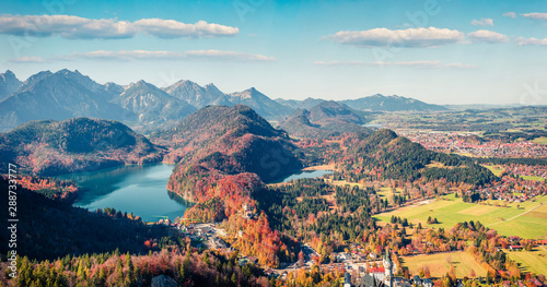 Obraz Aerial autumn panorama of Alterschrofen village in Fussen Germany. Sunny morning panorama of Bavarian Alps, Germany, Europe. Traveling concept background. - fototapety do salonu