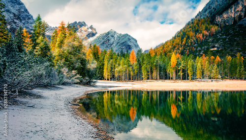 Obraz First snow on Braies Lake. Colorful autumn landscape in Italian Alps, Naturpark Fanes-Sennes-Prags, Dolomite, Italy, Europe. Artistic style post processed photo. - fototapety do salonu
