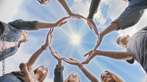 Fotografía  Conceptual symbol of cooperation diverse hands making a circle