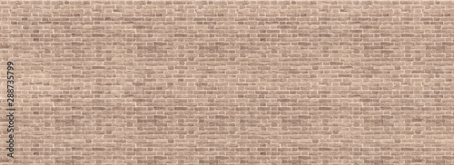 Papiers peints Graffiti Panoramic background of wide beige brick wall texture. Home or office design backdrop