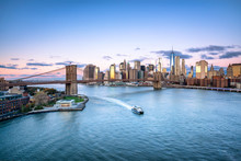 Aerial View Of The Manhattan Skyline And Brooklyn Bridge In New York City, USA