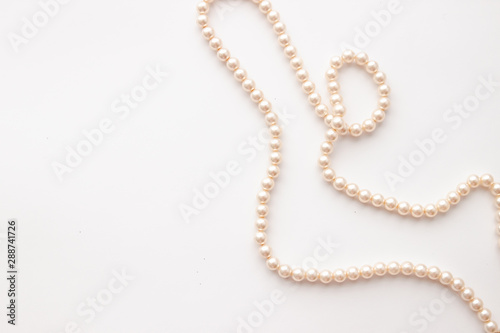 Leinwand Poster  Pearls on white background