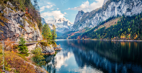 Fototapeta Colorful autumn panorama of Vorderer ( Gosausee ) lake with Dachstein glacier on background
