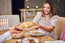 Hanukkah Dinner. Family Gathered Around The Table Sharing Challah