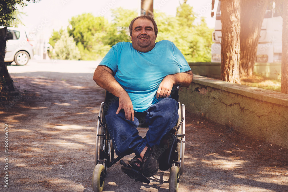 Fototapety, obrazy: disabled man in wheelchair walking park