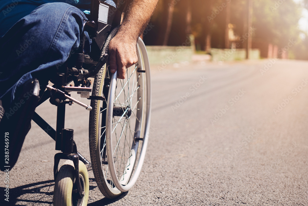 Fototapety, obrazy: Disabled man on wheelchair in the outdoor park like other people, Close-Up his wheel, Life in the education age of special man, Happy disabled man concept.