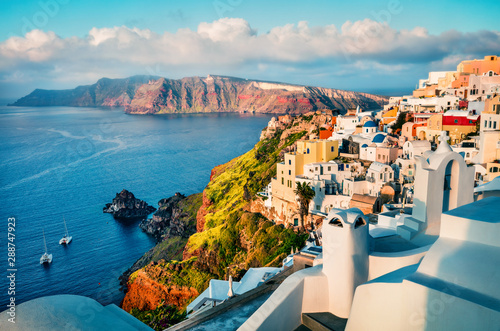 Fototapeta Colorful morning view of Santorini island. Picturesque spring sunrise on the famous Greek resort Oia, Greece, Europe. Traveling concept background. Artistic style post processed photo. obraz