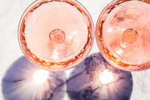 Two Crystal Stemmed Glasses With Rose Wine On Marble Table Outdoors In A Cafe. Aperitif And Relax Time