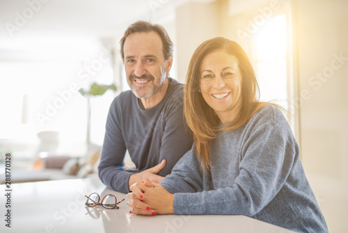 Romantic middle age couple sitting together at home Wallpaper Mural